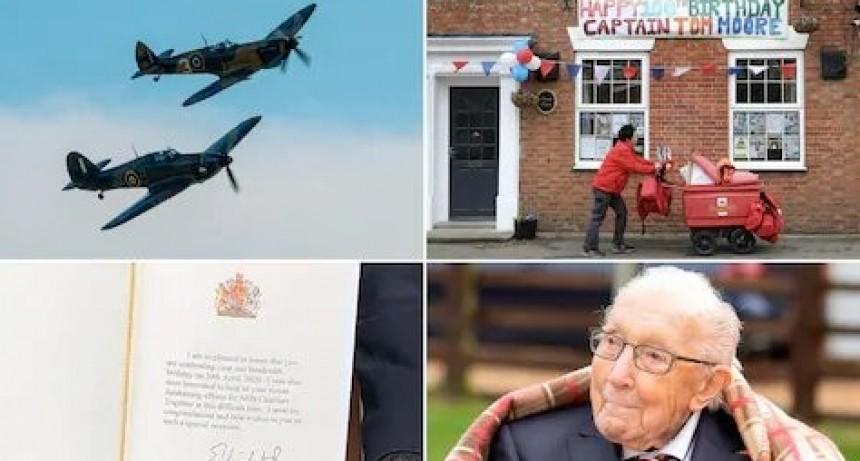 El Capitán Tom Moore observo el vuelo aéreo de la RAF con un Spitfire y un Hurricane para conmemorar su centenario