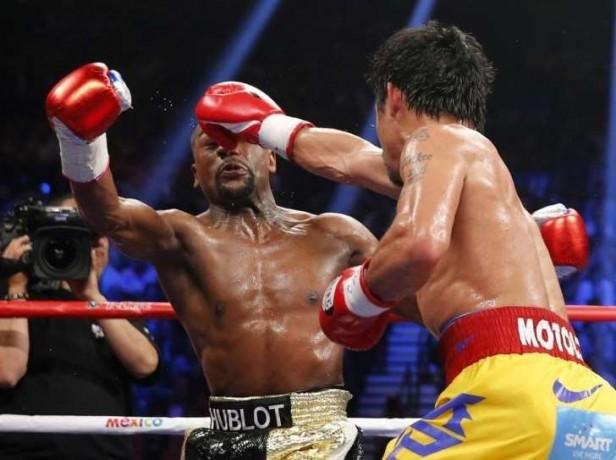 Pacquiao dice que peleo con una lesión en el hombro